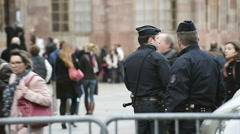 Police officers surveillance of Christmas Market Stock Footage