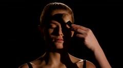 Professional face makeup for photo shooting. Black. Closeup Stock Footage