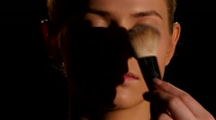 Make-up artist at work. Black. Closeup Stock Footage