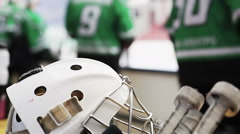 Ice hockey helmet and stick closeup, team players preparing for practice match Stock Footage