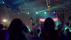 Silhouettes dancing at concert Stock Footage