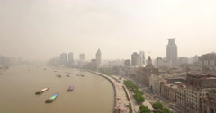 Shanghai Bund high angle pull back aerial Stock Footage