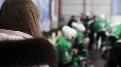 Female fan waiting for favorite hockey player to take autograph after match - stock footage