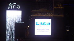 4K ES: Main Digital Marquee of the Bellagio & Aria Hotels on The Las Vegas Strip - stock footage