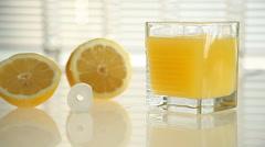 Lemon juice and half a ripe lemon. close-up Stock Footage
