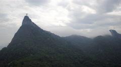 Aerial Christ de Redemer (Cristo Redentor) hills and Rio de Janeiro city Stock Footage