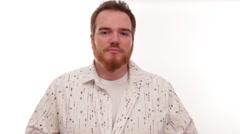 Hipster millennial buttoning up shirt Stock Footage