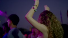 Pretty blonde hipster girl dancing with friends at concert Stock Footage