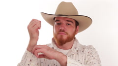 Hipster millennial cowboy with an ace up his sleeve - stock footage