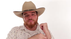 Hipster millennial cowboy with an ace up his sleeve with surprised eyes - stock footage