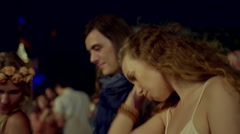 Group of friends dancing at concert - stock footage