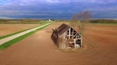 Stunning aerial flyby of beautiful abandoned barn at daybreak - stock footage