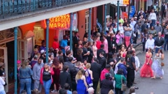 Many people havinng party on the streets in French Quarter New Orleans Stock Footage