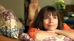 Happy, young woman relaxing on sofa in outdoor villa, super slow motion 240fps Stock Footage