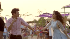 Man and woman dance at concert Stock Footage