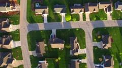 Beautiful, suburban homes at daybreak, aerial view - stock footage