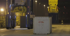 Container Crane Unloading A Ship (4K) Stock Footage