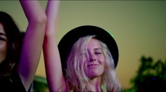 Cute blonde girl dances at concert Stock Footage