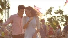 Happy couple dances at concert Stock Footage