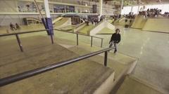 Roller skater with jump over fence, slip on springboard, make double flip Stock Footage
