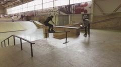 Roller skater make slip on fence in skatepark. Springboard. Cameraman. Challenge Stock Footage