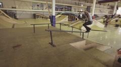 Roller skater make extreme stunt on fence in skatepark. Springboard. Challenge Stock Footage