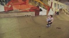 Roller skater make slip, stunts on springboard in skatepark. Challenge Stock Footage