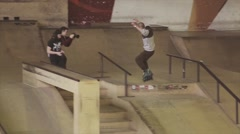 Roller skater jump over fence on contest in skatepark. Challenge. Competition Stock Footage