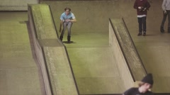 Roller skater slide on edge of springboard on contest in skatepark. Failing Stock Footage