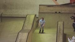 Roller skater slip on edge of springboard on contest in skatepark. Challenge Stock Footage