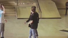 Roller skaters give five to each other on contest in skatepark. Challenge Stock Footage