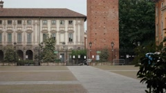 Medieval clock tower seen from university courtyard in Pavia, PV, Italy - stock footage