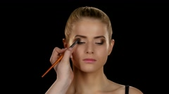 Makeup artist makes models eye makeup. Black. Closeup Stock Footage