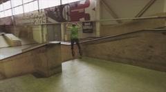 Roller skater make stunt on edge of springboard on challenge in skatepark Stock Footage