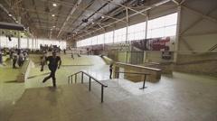 Roller skater rolls on edge of springboard on competition in skatepark. Jump Stock Footage