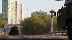A column of heavy  military ballistic rocket vehicles moving by Moscow street 5 Stock Footage