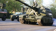 A column of heavy  military vehicles moving by streets of Moscow closeup Stock Footage