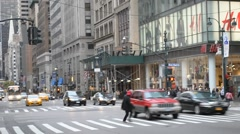 In NYC A Man Jaywalking And Many People Crossing The Street Intersection Stock Footage