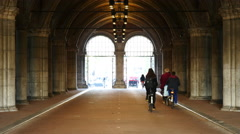 Time lapse of Bicyclists in the Rijksmuseum Building Tunnel - Amsterdam - stock footage