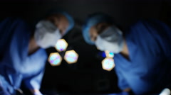 4K Surgeons working on patient in operating room, seen from patient pov Stock Footage