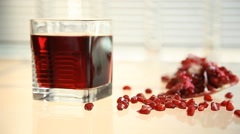 Pomegranate juice and pomegranate seeds. close-up Stock Footage