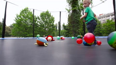 Ball Effort on the Child's Head - stock footage
