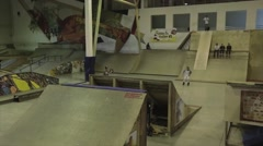 Roller skater make 360 flip in air. Springboard. Extreme trick. Competition Stock Footage
