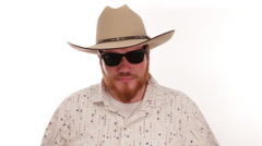 Hipster millennial cowboy tipping his cowboy hat with sunglasses on - stock footage