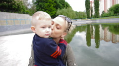 Mom Kissing Son Stock Footage