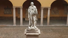 Alessandro Volta statue at University of Pavia, PV, Italy, zoom out Stock Footage