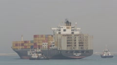 Cargo Ship With Tugboats In Harbor Stock Footage