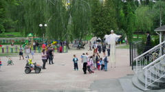 Two People on Stilts in the Park - stock footage