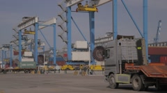 Container Cranes And Lorry Trucks - stock footage