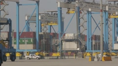 Straddle Carriers With Container Cranes Stock Footage